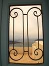 View to the sea through iron gate santorini greece Stock Images