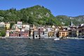 View to town of varenna from ferry crossing the lake como beautiful little but internationally famous situated at in a hot early Stock Photos