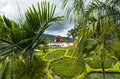 View to the traditional Thai temple in a garden Royalty Free Stock Photo