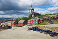 View to the traditional wooden houses and church bell tower of the copper mines town of Roros in Roros, Norway. Royalty Free Stock Photo