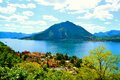 View to Varenna town, lake Como and Menaggio in summer. Royalty Free Stock Photo