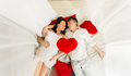 View from top of happy pregnant couple lying on bed with baldachin Royalty Free Stock Image