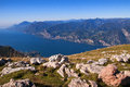 View from the top of monte baldo vista down lake at summit above malcesine on shores lake garda in northern italy Royalty Free Stock Images