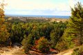 View from the top overlook of skyline trail in ludington state park forested sand dunes meet blue waters of lake michigan Stock Images