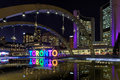 View of Toronto Sign on Nathan Phillips Square at night, in Toronto. Royalty Free Stock Photo