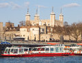 View of the tower of london from the river thames with busy city cruise tourist boats on the water the tower of london is a famous Stock Image