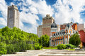 View of the tower of madrid torre de madrid and spain building edificio espana on blue sky background with white clouds in Royalty Free Stock Image