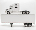 View of transport truck and trailer model on white, grey background