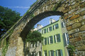 View under stone arch of historic district of Charleston, SC