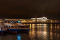 View on vasilevsky island stock exchange building and rostral columns night photography in the foreground walking ships Royalty Free Stock Image
