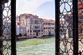 View through a venetian window at the canal grande palazzi in venezia italy seen of another palazzo Royalty Free Stock Photo