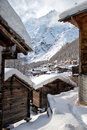 View of the village of saas fee swiss alpine in winter with its wooden houses with snow covered roof Royalty Free Stock Photography