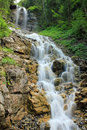 View at a waterfall in switzerland in the mountains beautiful coming down Stock Photo