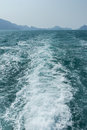 View of waves behind a boat Royalty Free Stock Photo