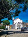 View of the white cathedral and the bright orange roofs of cascais houses Royalty Free Stock Photo