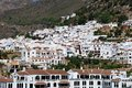 View of white village with mountains to the rear frigiliana malaga province andalucia spain western europe Stock Photography