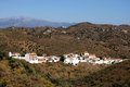 View of white village and surrounding countryside macharaviaya malaga province andalucia spain western europe Royalty Free Stock Photo