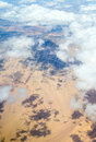 View from the window of an airplane flying aerial landscape near hurgada town over clouds in egypt Royalty Free Stock Photo