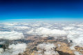 View from the window of an airplane flying aerial landscape near hurgada town over clouds in egypt Stock Image