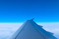 The view from the window of the plane airbus a at an altitude of meters wing aircraft in the sky Stock Images