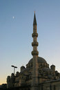 View of yeni camii the new mosque in istanbul at side with its minaret sunset sky is visible half moon Stock Photos