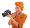 Viewing pictures camera surprised african woman on on white background Stock Photography