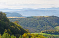 Viewpoint on a landscape of mount Bobija, hills, haystacks, meadows and colorful trees Royalty Free Stock Photo