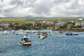 Views of boats and houses arriving at colorful puerto baquerizo moreno galapagos ecuador april in san cristobal island Stock Photo