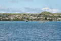 Views of boats and houses arriving at colorful puerto baquerizo moreno galapagos ecuador april in san cristobal island Royalty Free Stock Photo