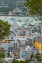 Views from the hillside in nearby St Antoni de Portmany Balearic Islands, Ibiza, Spain.  Marina with moored boats for the season. Royalty Free Stock Photo