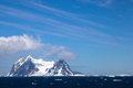Views from the lemaire channel antarctica snow covered mountains tower above ocean under a beautiful blue sky day Stock Image