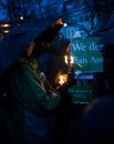 Vigil for newtown shooting victims dozens of vermonters gathered at city hall park in burlington vermont a candle light held in Royalty Free Stock Photo