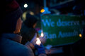 Vigil for newtown shooting victims dozens of vermonters gathered at city hall park in burlington vermont a candle light held in Stock Image