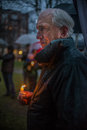 Vigil for newtown shooting victims dozens of vermonters gathered at city hall park in burlington vermont a candle light held in Stock Photos
