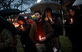 Vigil for newtown shooting victims dozens of vermonters gathered at city hall park in burlington vermont a candle light held in Royalty Free Stock Photography