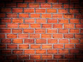 Vignette orange brick wall background a Stock Image