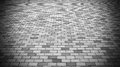 Vignette Perspective View of Monotone Gray Brick Stone Street Road. Sidewalk, Pavement Royalty Free Stock Photo