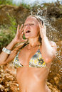 Vigorous young woman on seashore Royalty Free Stock Photo