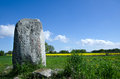 Viking age stone old historic runic at karlevi on the swedish island oland image from springtime with blue sky and green yellow Royalty Free Stock Photos