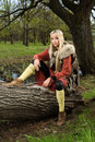 Viking girl  with sword in a wood Royalty Free Stock Image