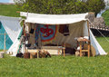 Viking tent camp and marquees at a reconstruction event with utensils for cooking Royalty Free Stock Image