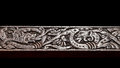 Viking wood carving like depicting two fire breathing dragons fighting Royalty Free Stock Photos