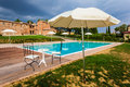 Villa a beautiful and luxurious tuscany swimming pool with parasols and chairs Stock Photo