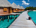 Villa on piles on water.Maldives.Island in ocean Stock Photos