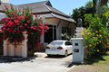 Villa in tropics and white car Royalty Free Stock Image