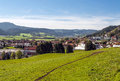Village of alsace french situated in surrounded by fields on a sunny day you can see mountains in the background Stock Image