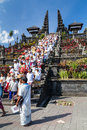 Village of Besakih, Bali/Indonesia - circa October 2015: People are returning from praying in Pura Besakih  temple Royalty Free Stock Photo