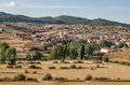 Village of bezas view called in the spanish province teruel we see the fields cereals on a day with clouds the mountain are Royalty Free Stock Photos