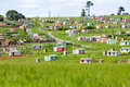 A village of brightly colored Mandela Houses in Zulu Village, Zululand, South Africa Royalty Free Stock Photo