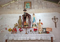 Village catholic church an alter in a in a remote in the mountains of luzon island philippines displays statues of blessed virgin Royalty Free Stock Images